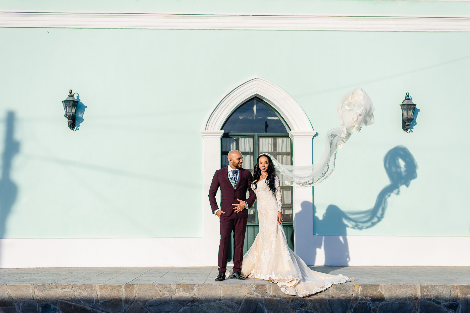 Bride and Groom walking on the streets of Todos Santos during their photo session with Gonzalo Verdeja photographer