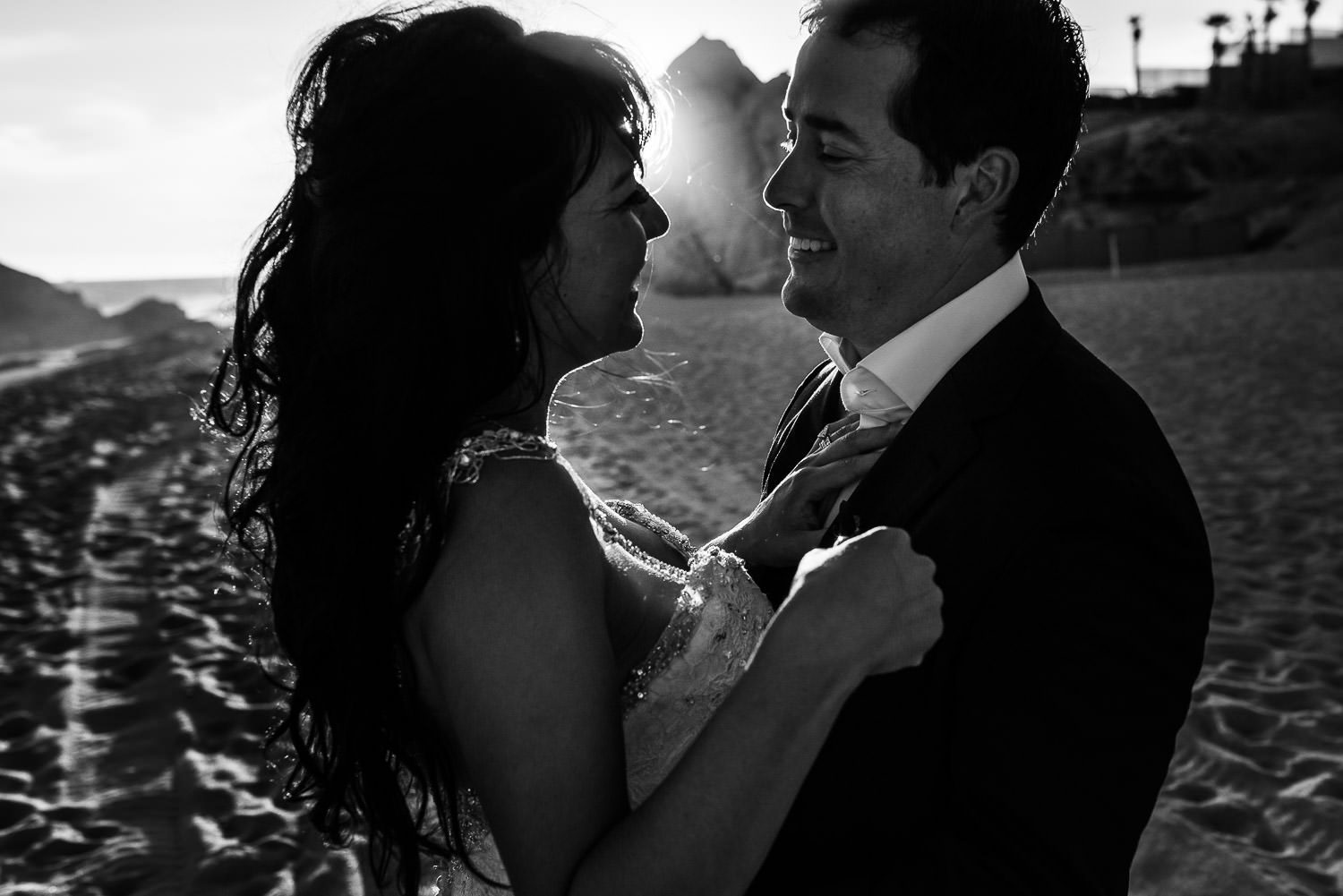 Bride and groom during their first look photo session on the beach with talented gvphotographer