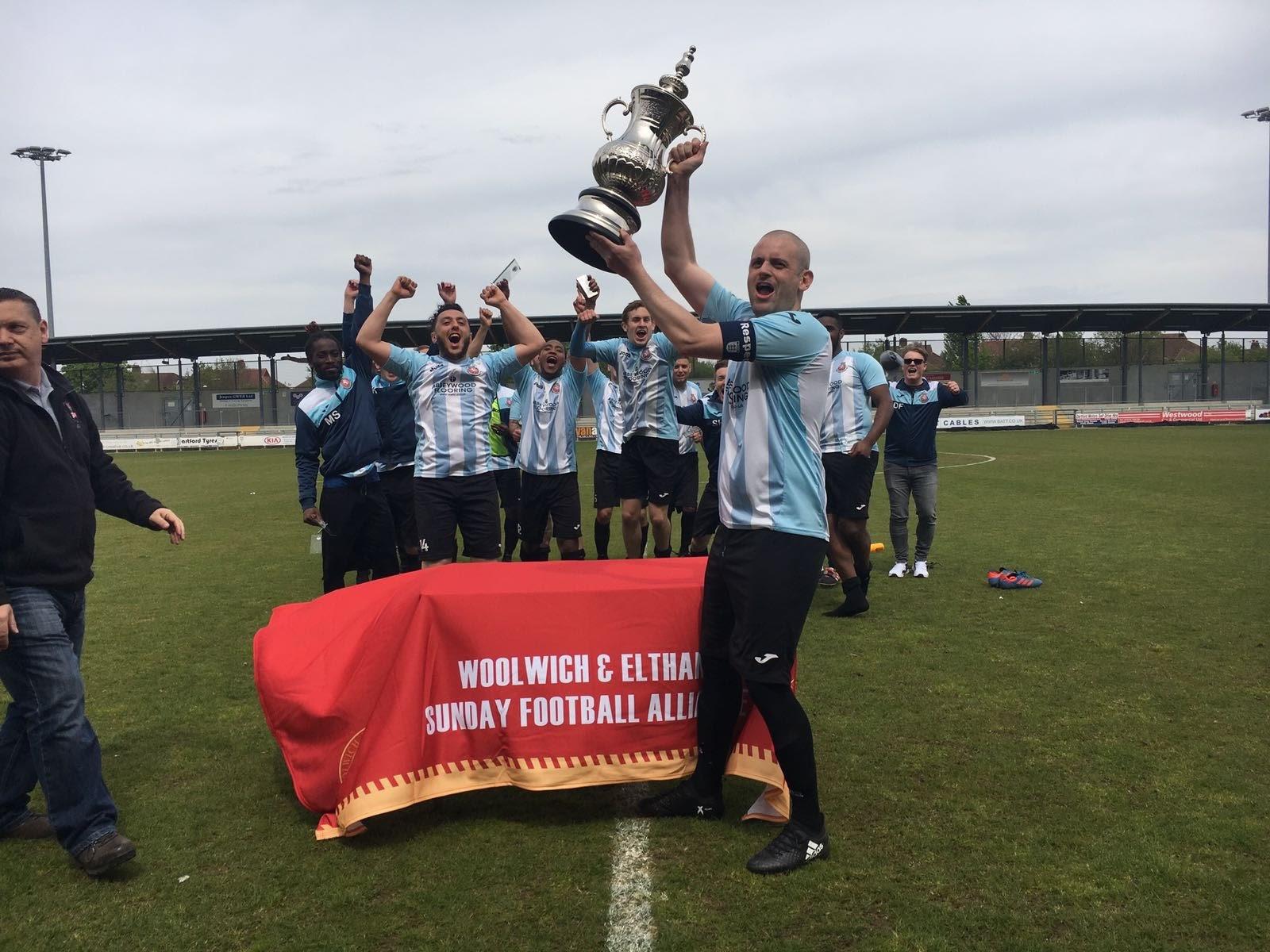 Kent Wanderers captain lifts the Len Wareham Cup