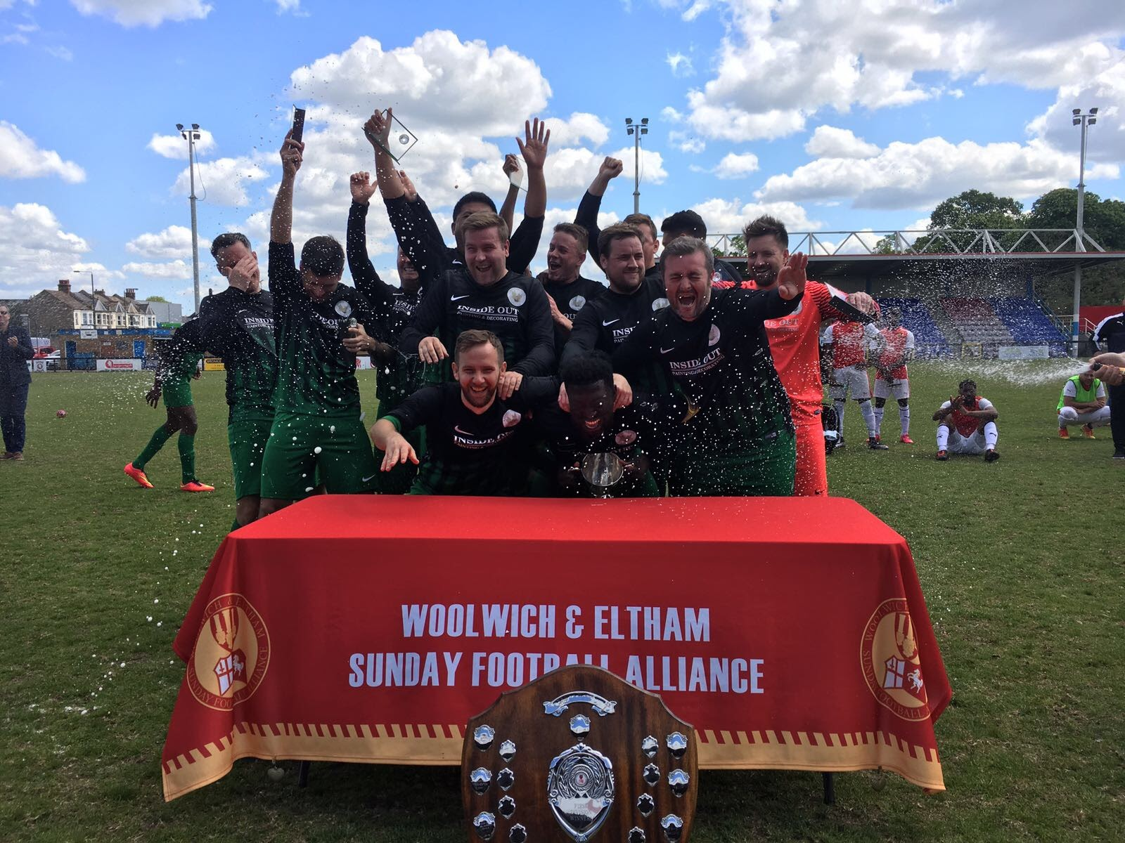 Woodside Celtic lift the Alliance Cup, with the Division One shield in the foreground