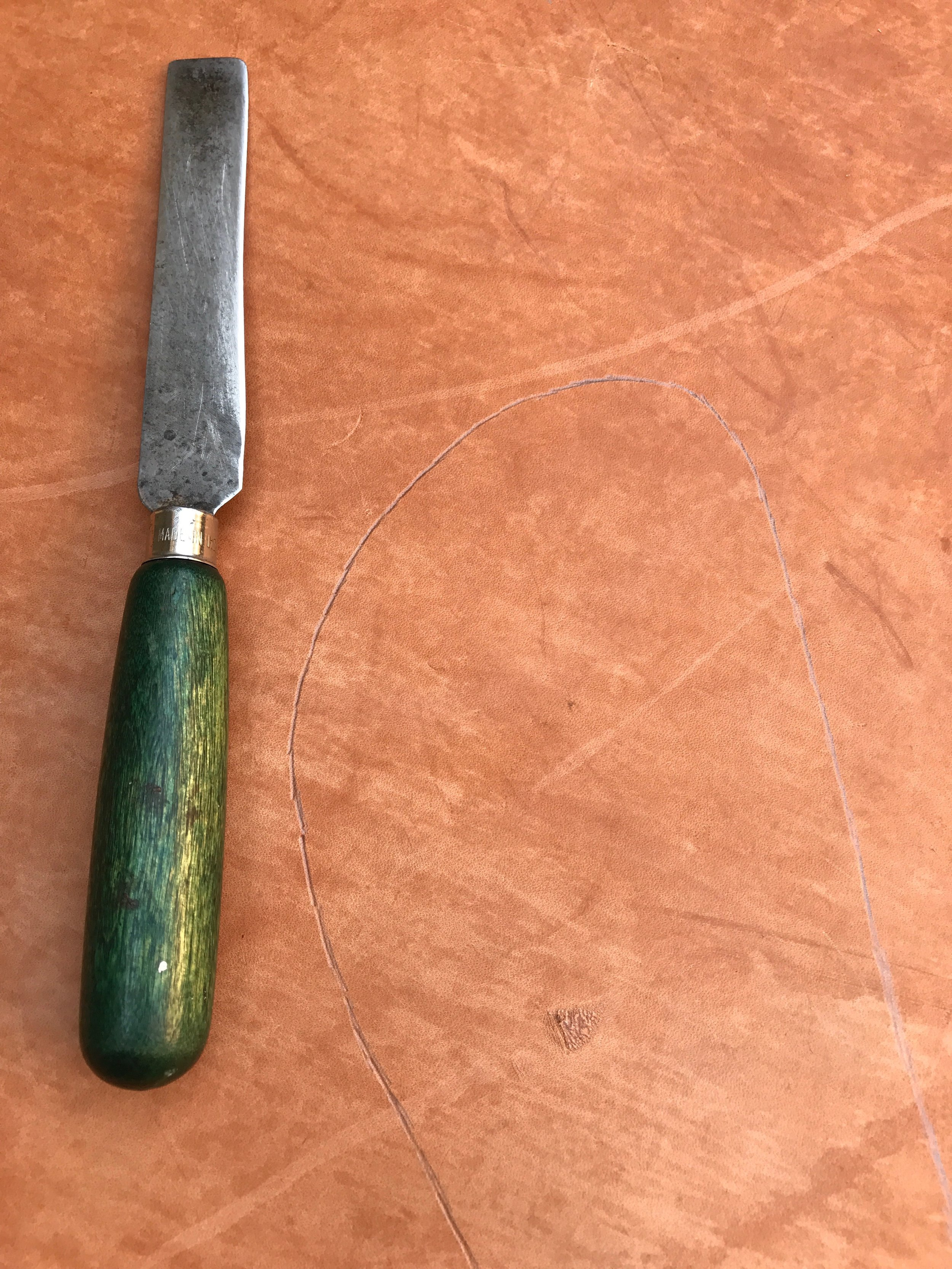 This gorgeous knife also happens to be one of my favorite colors. This is the shape of my foot on the sole leather.