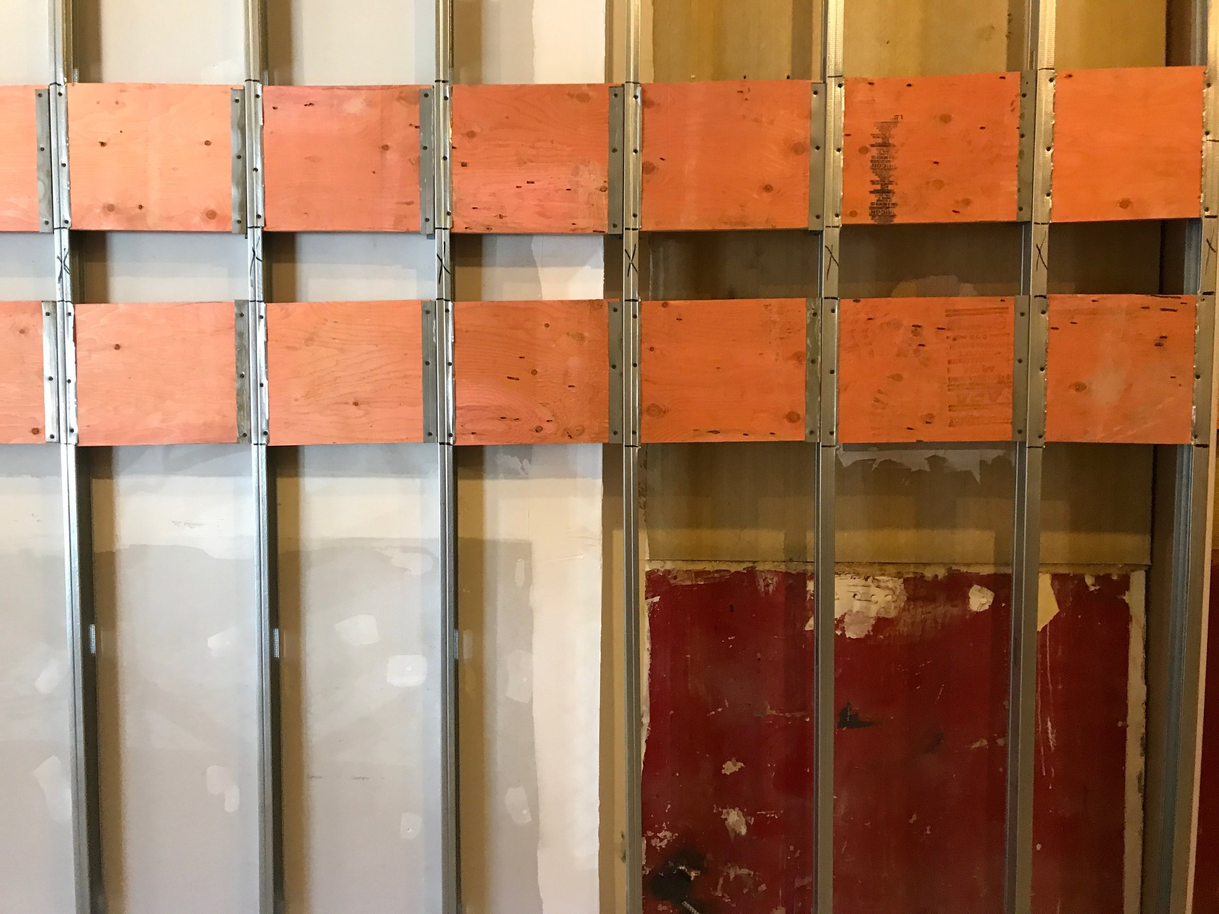 If memory serves these orange panels are this color because they're treated with a flame retardant and I loved the color so much I kept a sample to work with later on.