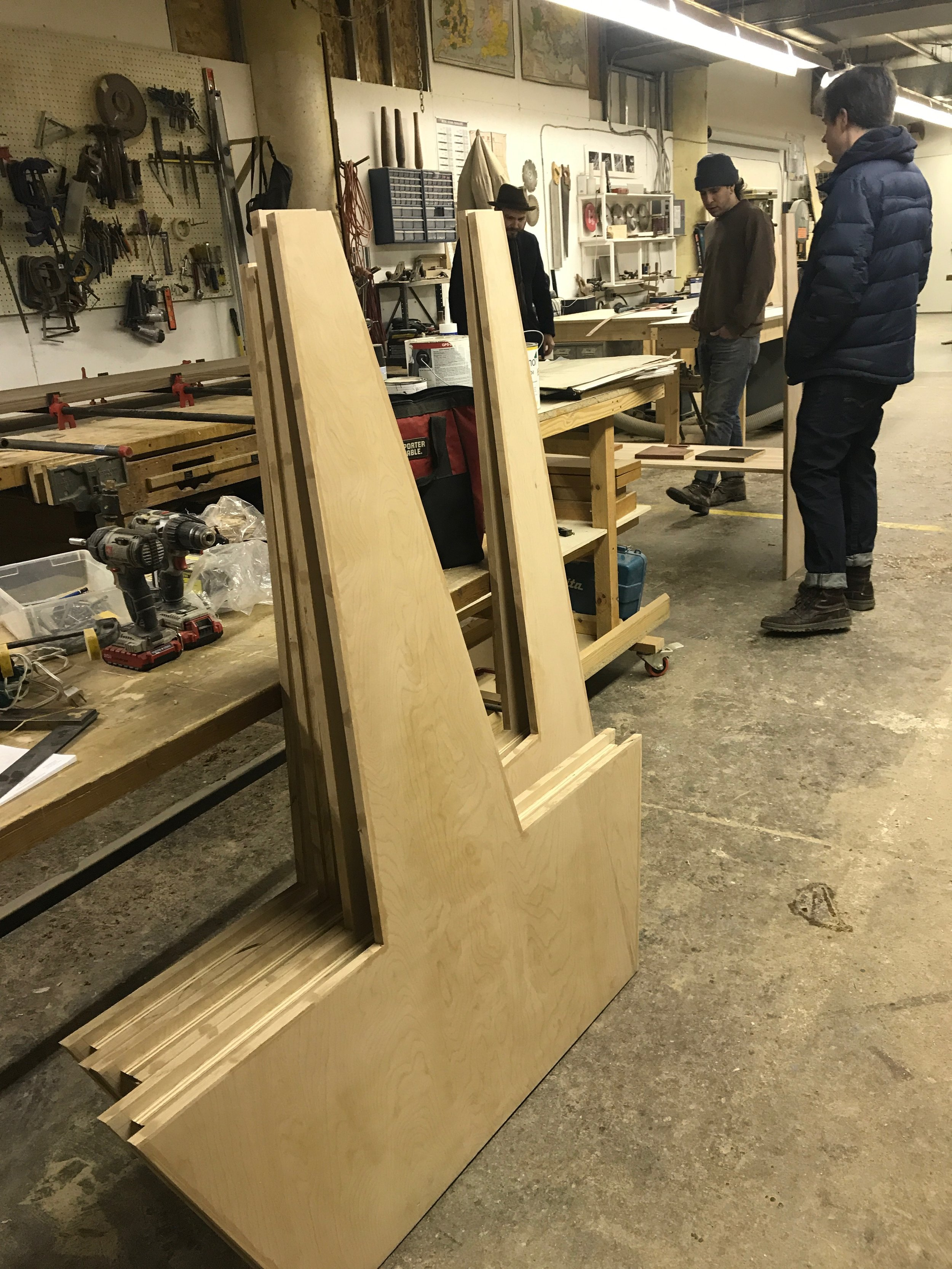 Meeting Steven the Carpenter at his workshop in Manchester to check out the booths, match stains, and discuss tabletops.