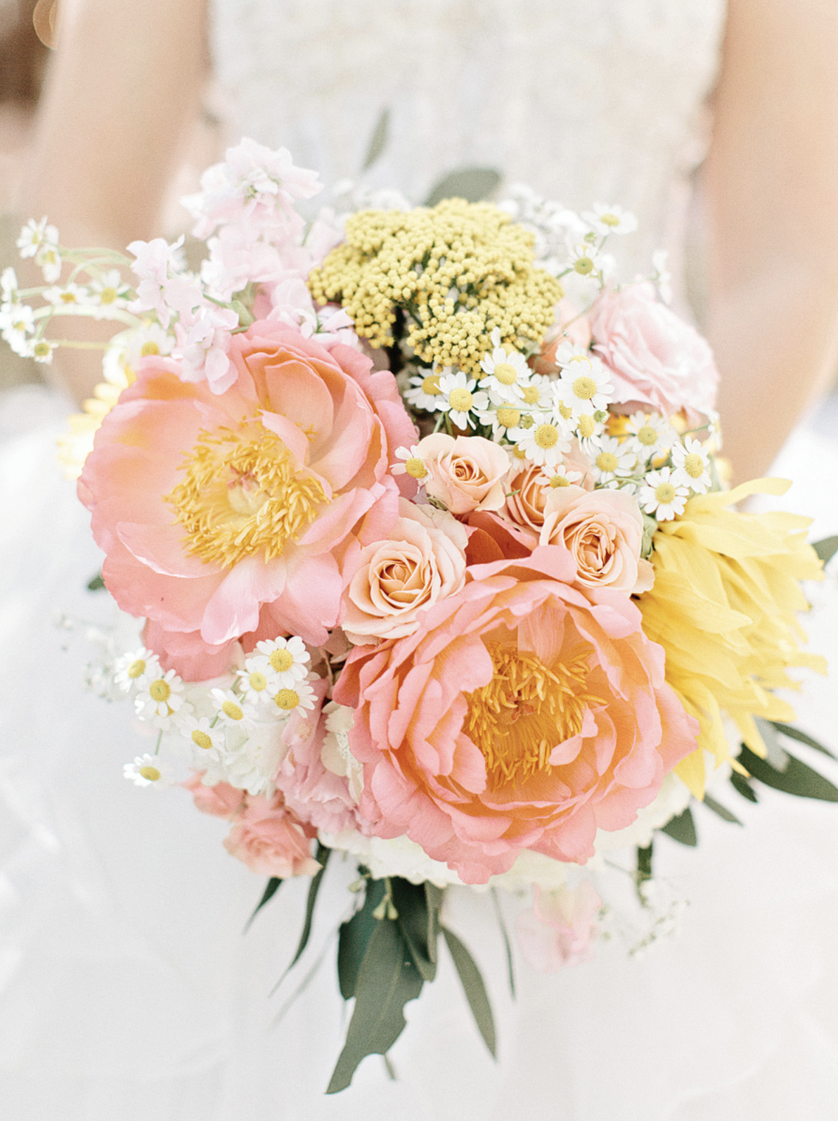 Coral peonies, roses, daisies and achillea | Photo by  Amy Arrington Photography