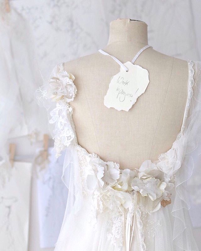 "Prettiness behind the scenes... we're always happier when we're immersed in a hive of creativity, and there's some really beautiful dresses on the rail waiting for their brides to be.⠀ ⠀ ⠀ This is a bespoke version of ""Meadow"" , the most romantic bridal gown in silk crepe with a  tulle overlay and ruffled straps. ⠀ ⠀ ⠀ We have a room full of dreses for brides to try on, and these can all be customised too, or if you would like us to bring your ideas to reality we can create a couture dress just for you. ⠀ ⠀ ⠀ *⠀ *⠀ *⠀ *⠀ *⠀ #bridaldesigner #weddingdressmaker #atelier #bridalgown #madeforme #madetomeasure #findmydress #weddingplanning #behindthescenes #designerlife #madewithlove #bespokedress #workinprogress #silkdress #sugnall #couturebride #bespokebride #pursuepretty #thatsdarling #thehandmademovement #sarahwillard #artisanprocess #creativityfound #creativeprocess #staffordshirebride #shropshirewedding #bridalcouture #designerweddingdress"