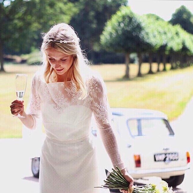 "REAL WEDDING: A relaxed picnic in the grounds of a country house, a Mini and a glass of bubbly... wedding day goals! ⠀ ⠀ ⠀ Love this photo of one of our real brides, wearing a bespoke version of ""Elena"" , an overdress with a skirt in soft tulle, with a Chantilly lace bodice with cowl front and a low back. ⠀ ⠀ ⠀ ""Thank you for making us all feel a million dollars... your creativity and attention to detail is amazing!""⠀ ⠀ ⠀ Repost from @bellesandconfetti using @RepostRegramApp - Boho bride Kate arriving in style 🕊💞 . . ⠀ ⠀ ⠀ *⠀ *⠀ *⠀ ⠀ #realbride #sarahwillardcouture #couturebride #bespokebride #weddingday #weddingphotography #laceweddingdress  #beautifulbride #staffordshirewedding #staffordshirebride ⠀ #Englishcountrywedding #bohobride #summerweddings #bridaldesigner #bridalfashion #bridalgown #weddingdress #weddingdressmaker #findmydress #gettingmarried #engaged #isaidyes #bride2020 #bridalstyle #realwedding"
