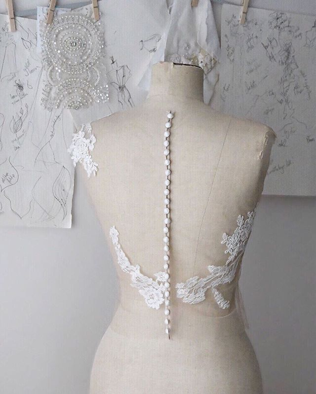 A glimpse behind the scenes,  and this beauty, a bodice with hand-sewn French lace applique on invisible tulle, and all the buttons... ✂️⠀ ⠀ ⠀ *⠀ *⠀ *⠀ *⠀ *⠀ #bridaldesigner #weddingdressmaker #bridalatelier #bridalgown #madeforme #madetomeasure #findmydress #weddingplanning  #designerlife #madewithlove #bespokedress #silkdress #couturebride #smallmomentsofcalm #bespokebride #pursuepretty #thatsdarling #onmysewingtable #thehandmademovement #sarahwillardcouture #artisanprocess #creativityfound #staffordshirebride #shropshirewedding #bridalcouture #designerweddingdress