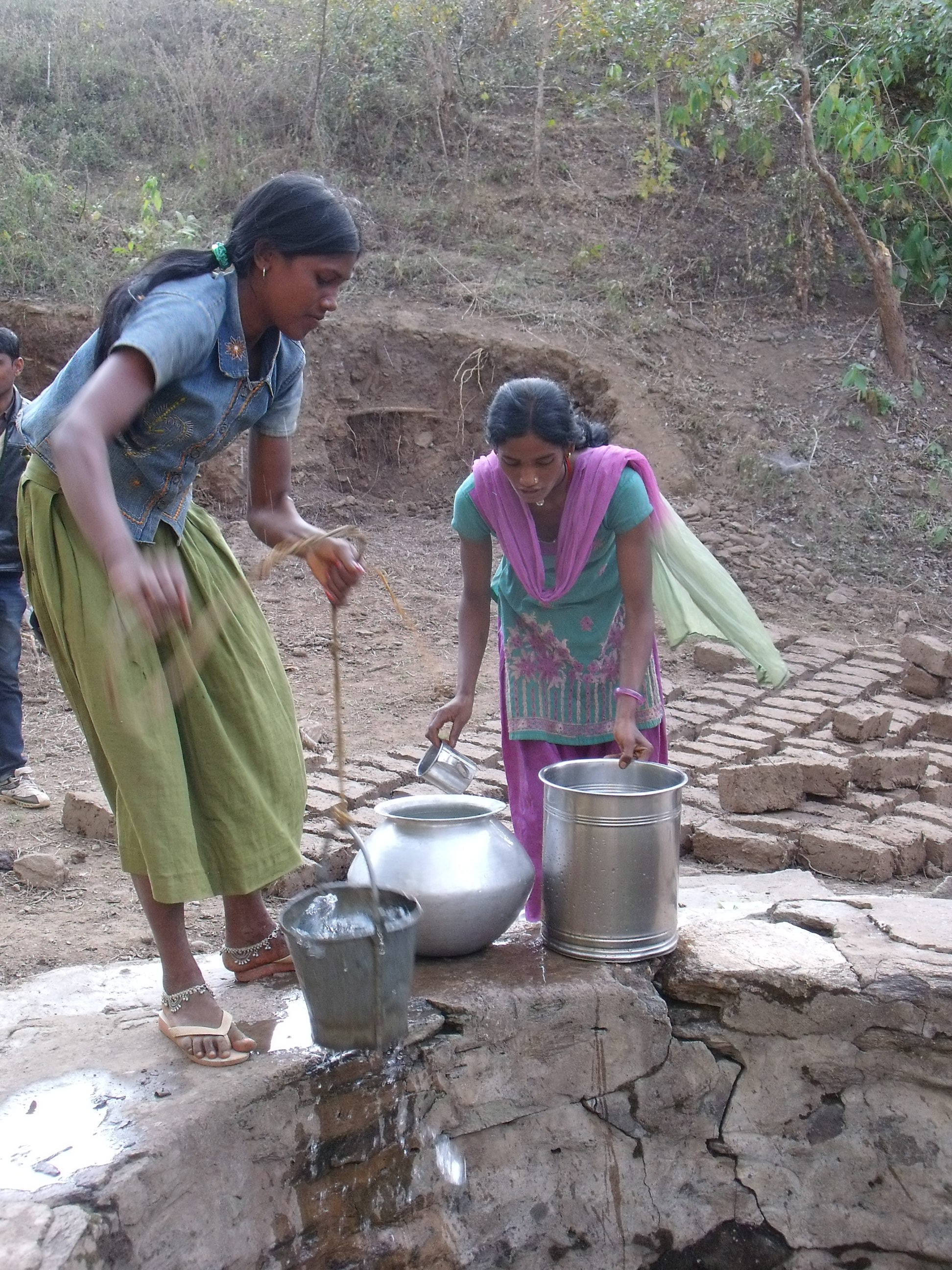 Sonia & Vimla collect water from a well