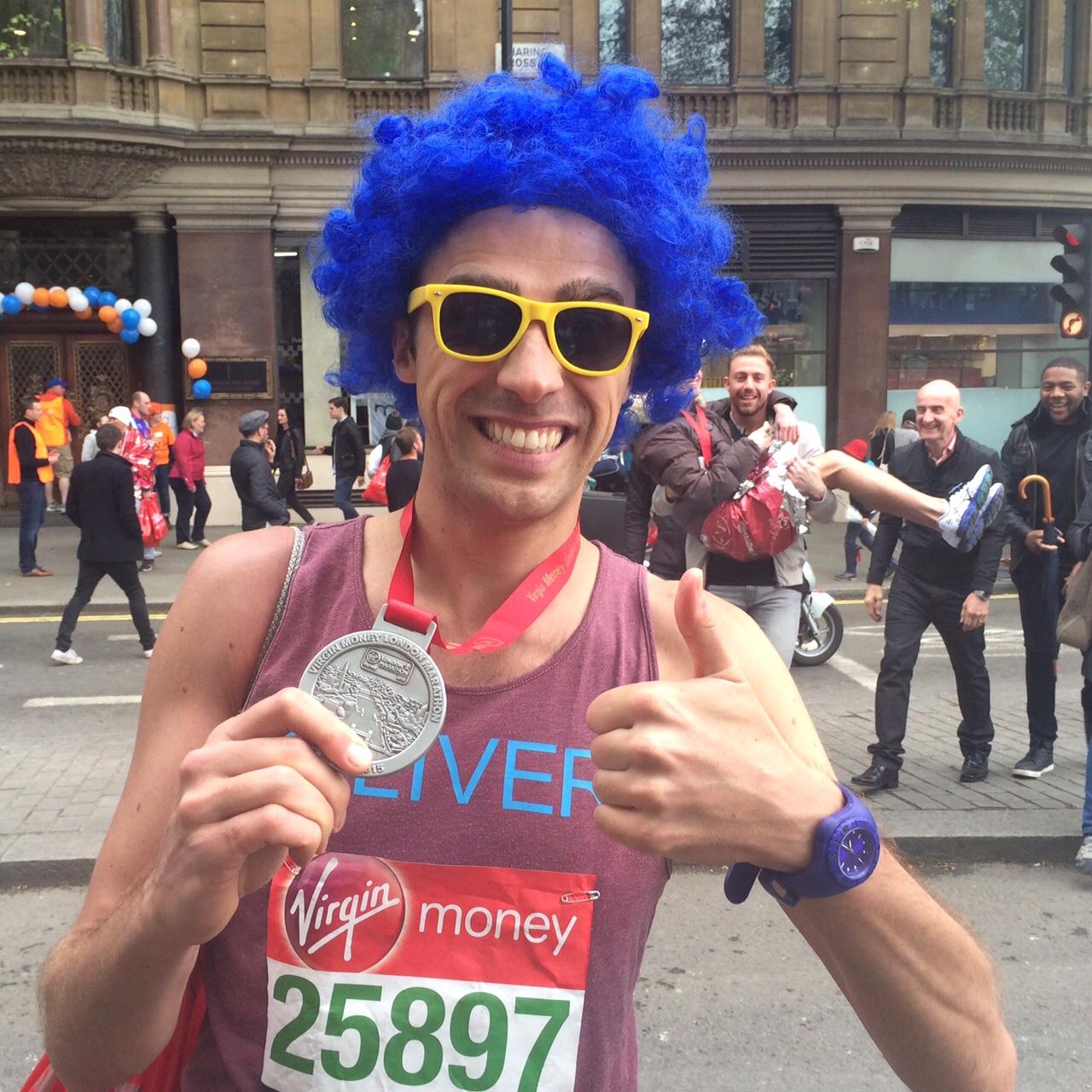 post marathon with medal.jpg