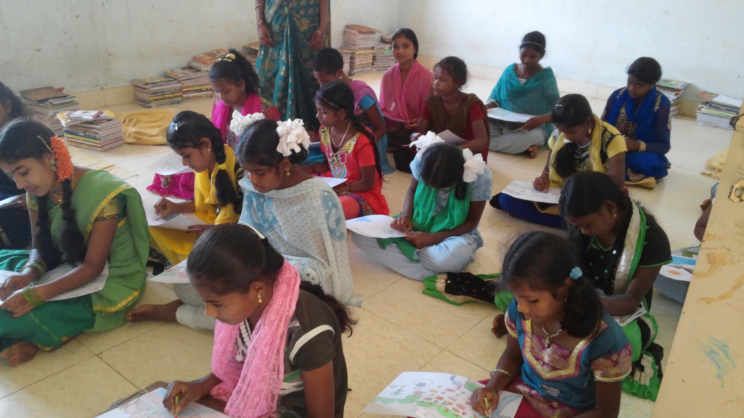 Girls take part in a drawing competition for World Water Day. Credit: VJNNS