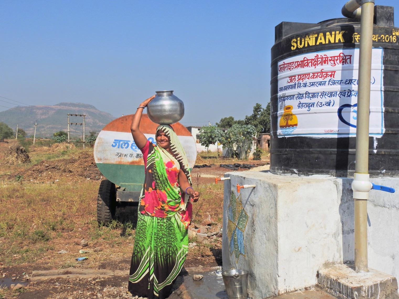 Resham collects water from FRANK Water safe water supply