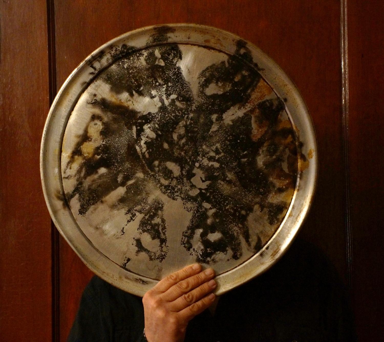 """Multitasking , 2015. 18"""" (diameter.) Aluminum, carbon."""
