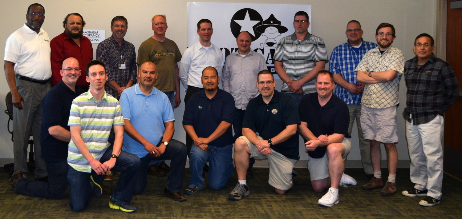 Boot Camp Coaches stand WITh National Trainer Will Housley (Left, between rows) and National Training Director Chuck Ault, (Back Row, Third from left) at the April 2016 Master Coach Training in Denver, Colorado.