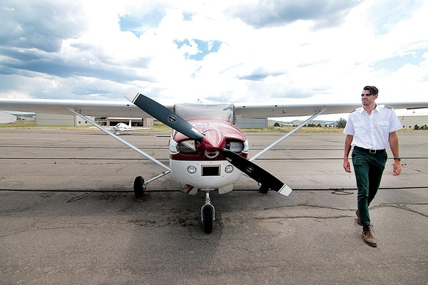 Owner of local scenic flight company Tall Pines Aviation, Max Wholey, prepares the Cessna 182 for an afternoon flight over the La Platas recently. Wholey, who is only 25 but spent his most of his life learning to fly, operates out of the Animas Airpark./Photo by Jennaye Derge