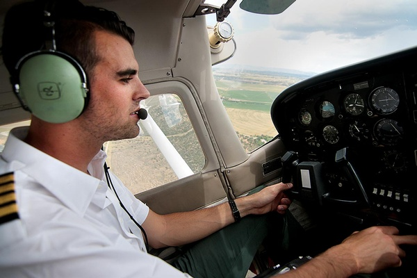 Wholey at the controls. He obtained his pilot's license when he was 18./Photo by Jennaye Derge