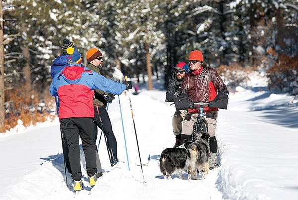 Trail users stop to chat at Boggy Draw on Fri., Jan. 27. The popular mountain biking area just outside Dolores is now being groomed by a dedicated crew of volunteers for winter use. There are 17.5 miles of track for cross country skiing, snowshoeing and fat biking./Photo by Jennaye Derge