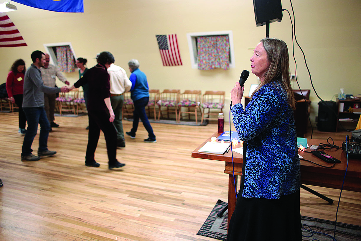 Carla Roberts calls out moves during a recent square-dancing event. Inspired by an- other female caller she met some years ago, she has been calling the Wild West Squares for four years./Photo by Jennaye Derge