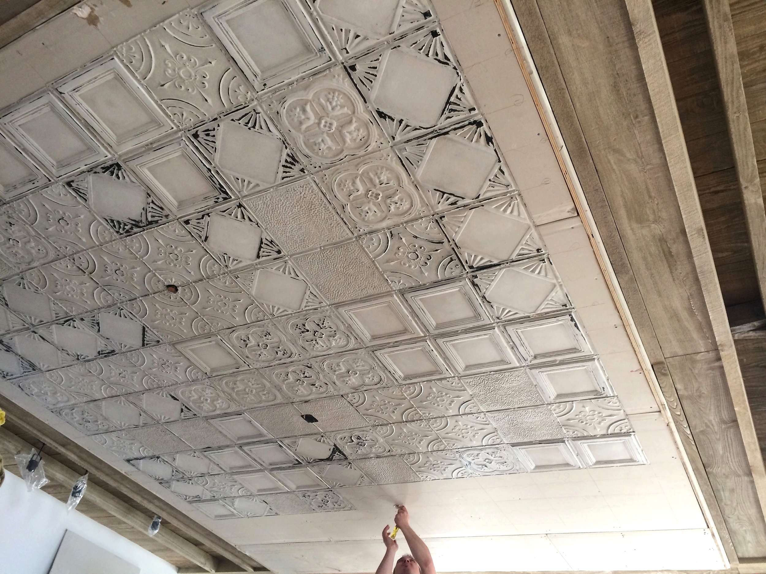 Our Distressed Tin Ceiling Tiles Being Installed