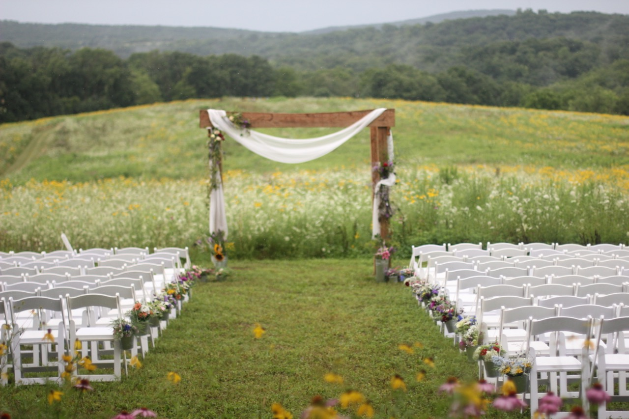 Enjoying the View from the Prairie and our Flower Design Handiwork. While we had to move all the flower decor into the Reception Tent space due to heavy rains, for a moment, our floral gratitude to the land.