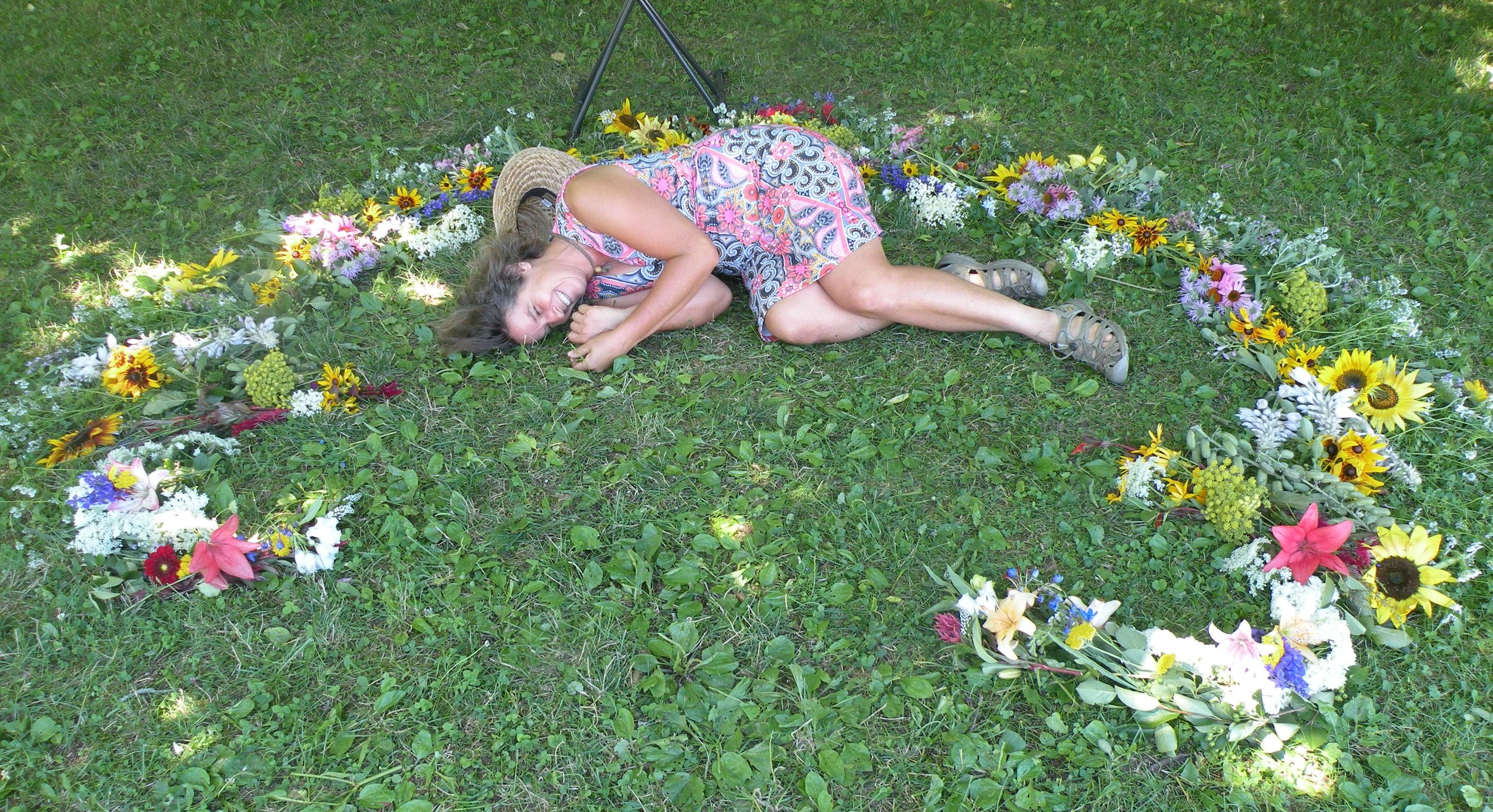 Relaxing after putting the finishing touches on a flower mandala as part of a wedding ceremony. Photo by Rob McClure