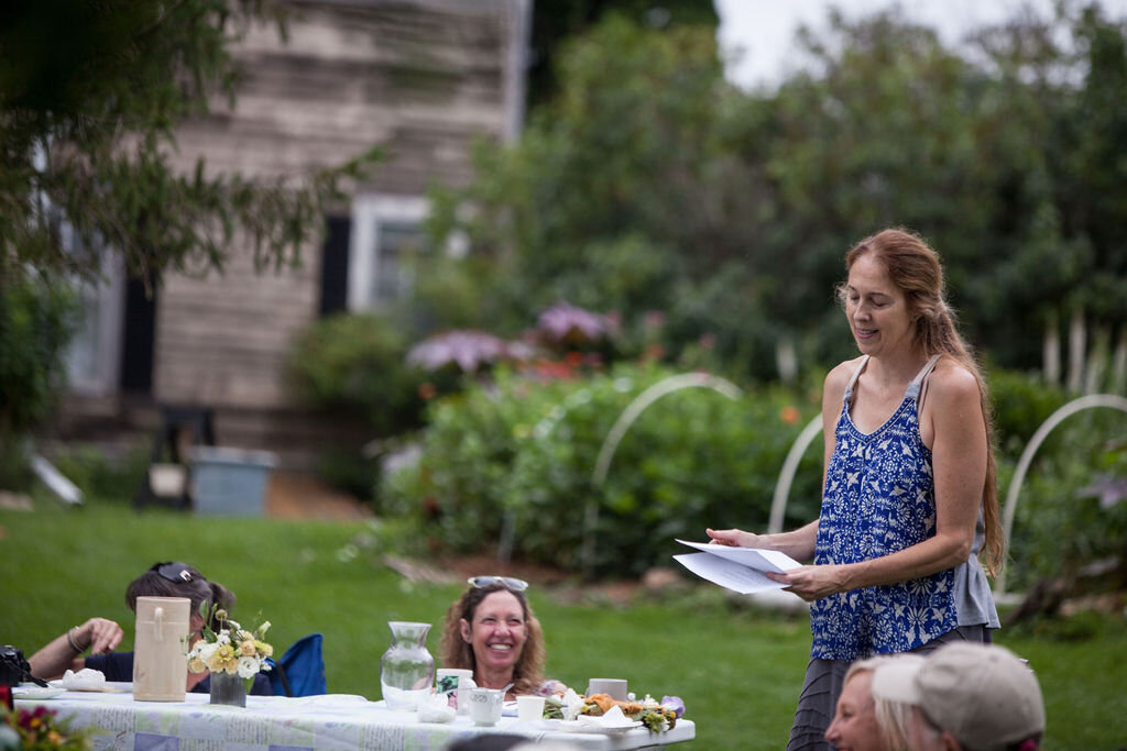 Katrin Talbot reading poems as part of our Brunch n Blooms meets Poetry in Bloom. event at the farm. Photo by Treasure People Photography