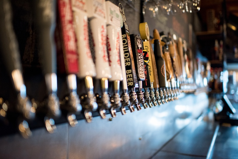 The tap line up at Three Four Beer Company in Fort Collins, Colorado. Film photography by Sonja Salzburg of Sonja K Photography.