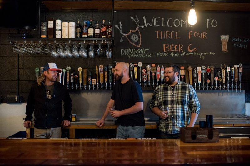 The owners of Three Four Beer Company enjoy a laugh. Film photography by Sonja Salzburg of Sonja K Photography.