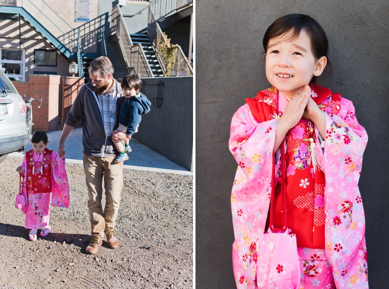An adorable little girl in a bright, flowery, pink kimono for the first time. Film family portraits by Sonja Salzburg of Sonja K Photography.