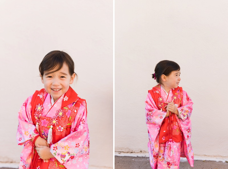 An adorable little girl in a red and pink kimono for the first time. Film portraits by Sonja Salzburg of Sonja K Photography.