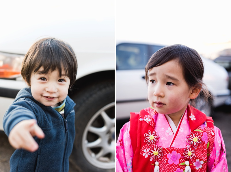 An adorable little boy and his sister wearing a bright red and pink kimono. Family film portraits by Sonja Salzburg or Sonja K Photography.