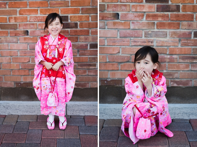 A beautiful little girl in a bright flowery pink kimono for the first time in a ceremony called Shichi-Go-San. Film portraits by Sonja Salzburg of Sonja K Photography,