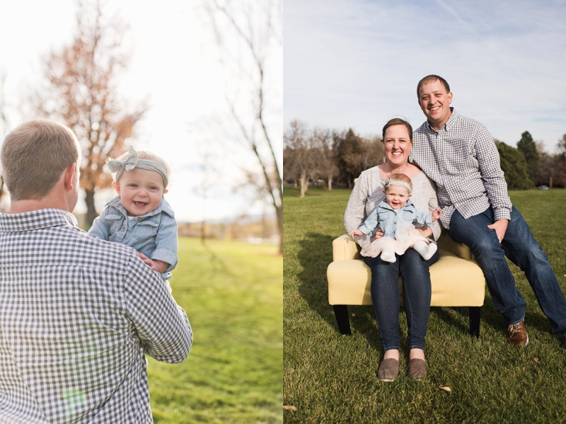 A happy baby girl in her father's arms. A happy family on a bright fall day at a park.  Film family portraits by Sonja Salzburg of Sonja K Photography.