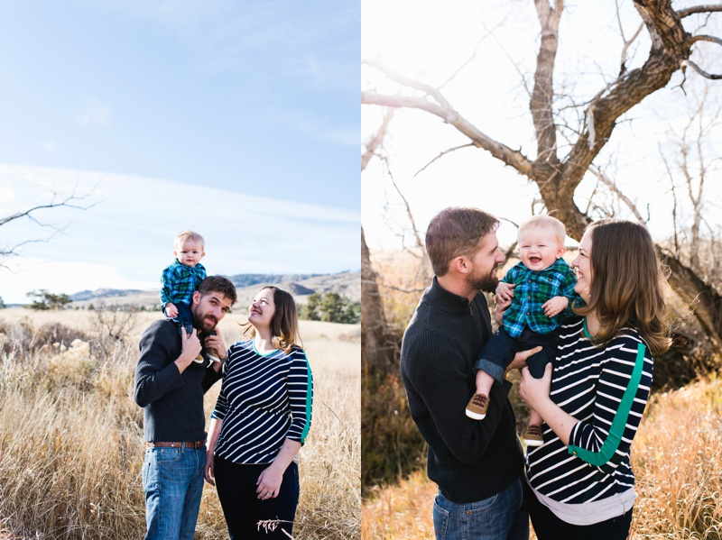A young couple with a baby stand in a warm and sunny fall grassland. Film family portraits by Sonja Salzburg of Sonja K Photography.