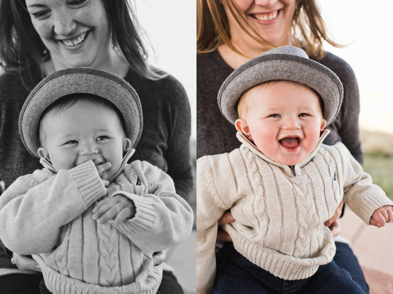 A happy laughing baby boy sits on his mother's lap. Film family portraits by Sonja Salzburg of Sonja K Photography.