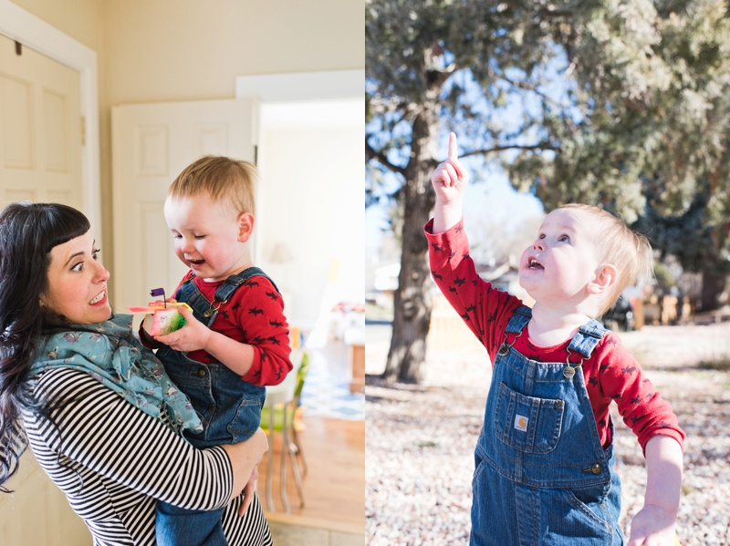 a fun mother holds and plays with her handsome son and an adorable child in a red shirt and denim overalls. Film family portraits by Sonja Salzburg of Sonja K Photography.