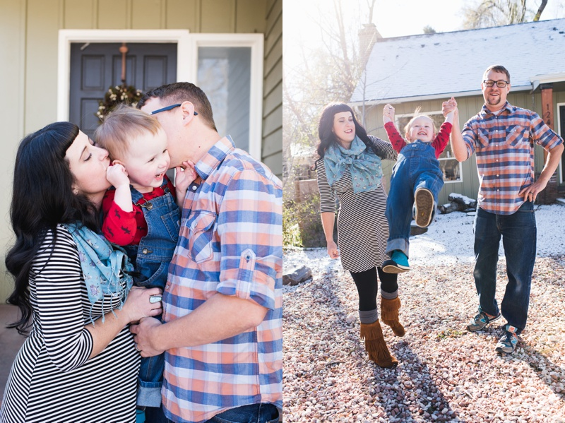 a beautiful young family with their son in front of their home kisses the happy boy. a happy couple swing their smiling son in their backyard. Film family portraits by Sonja Salzburg of Sonja K Photography.