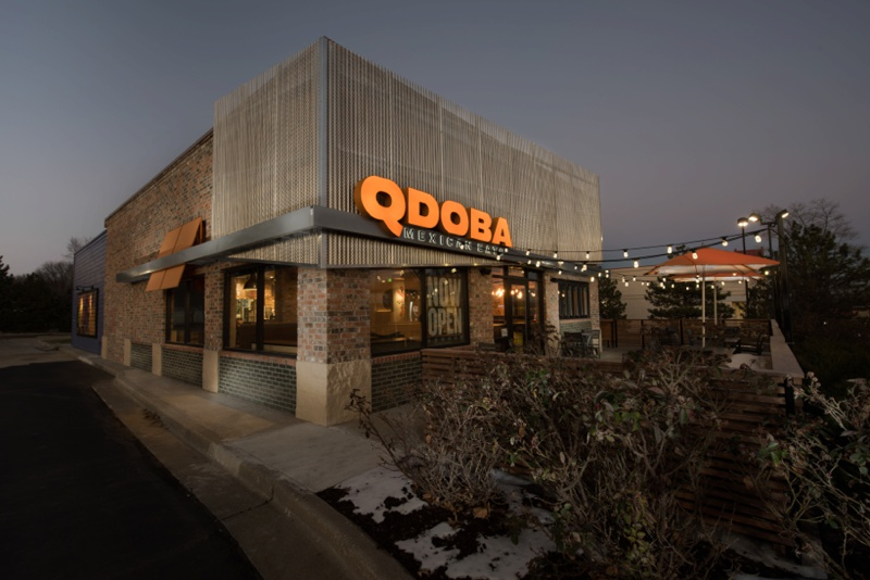 A beautifully lit redesigned Qdoba Mexican Eats location in Kansas City at dusk. Architectural photography by Sonja Salzburg of Sonja K Photography.