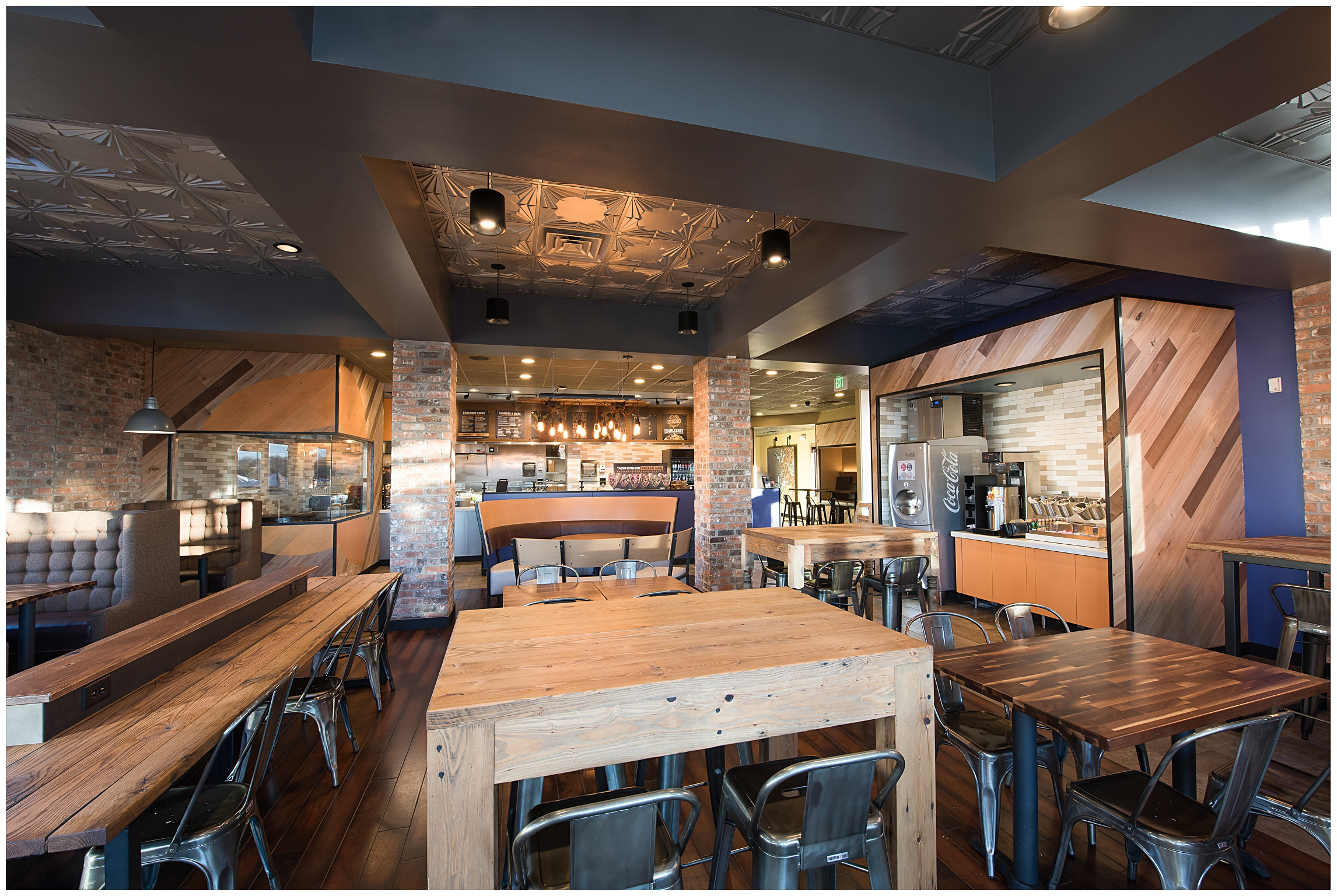 A brand new and redesigned dining room in a Qdoba Mexican Eats location in Kansas City, Missouri awaits hungry customers. Corporate photography by Sonja Salzburg of Sonja K Photography.