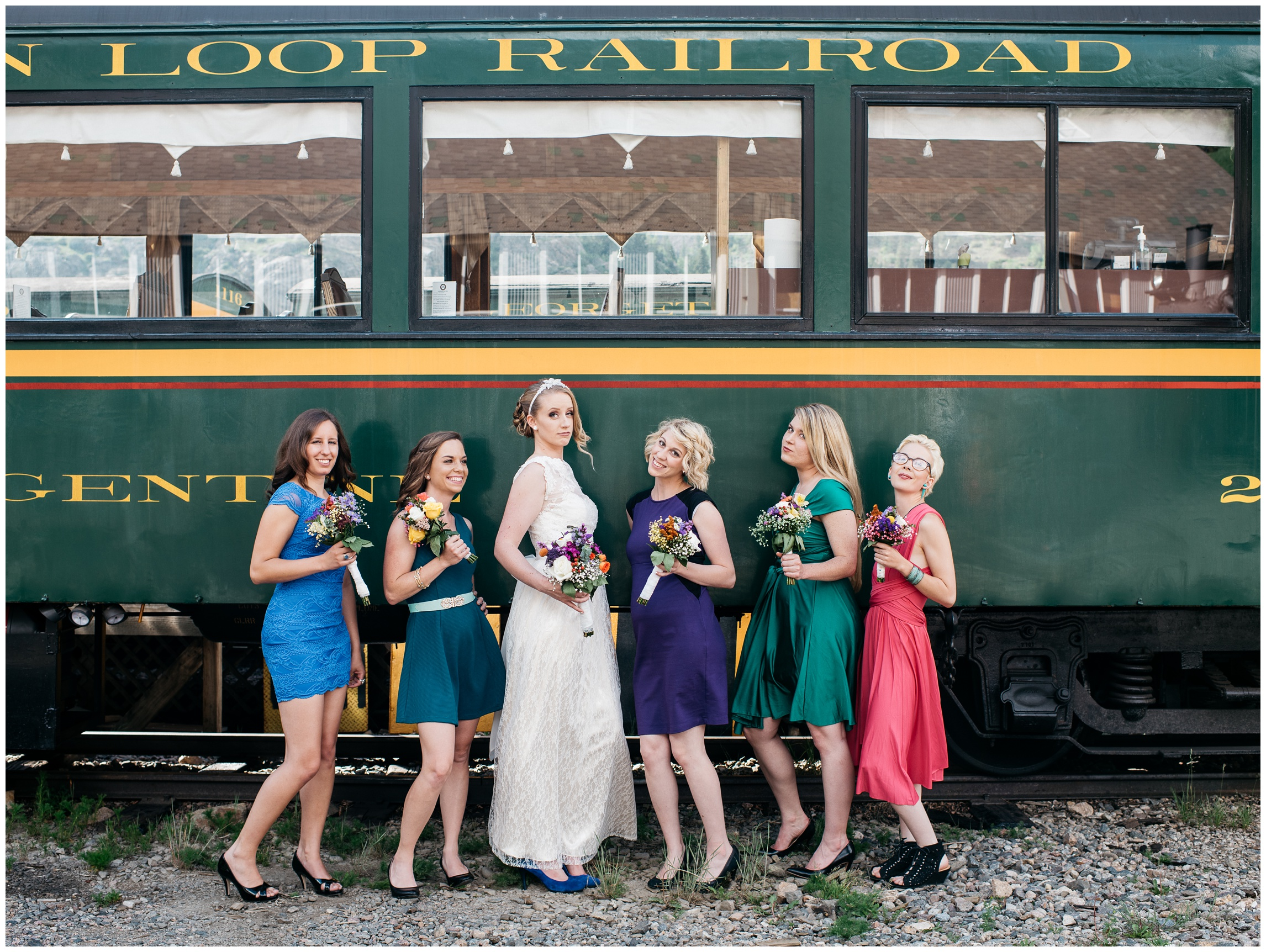 Bridesmaids and a bride in front of a historic train in Georgetown, Colorado. Wedding photography by Sonja Salzburg of Sonja K Photography.