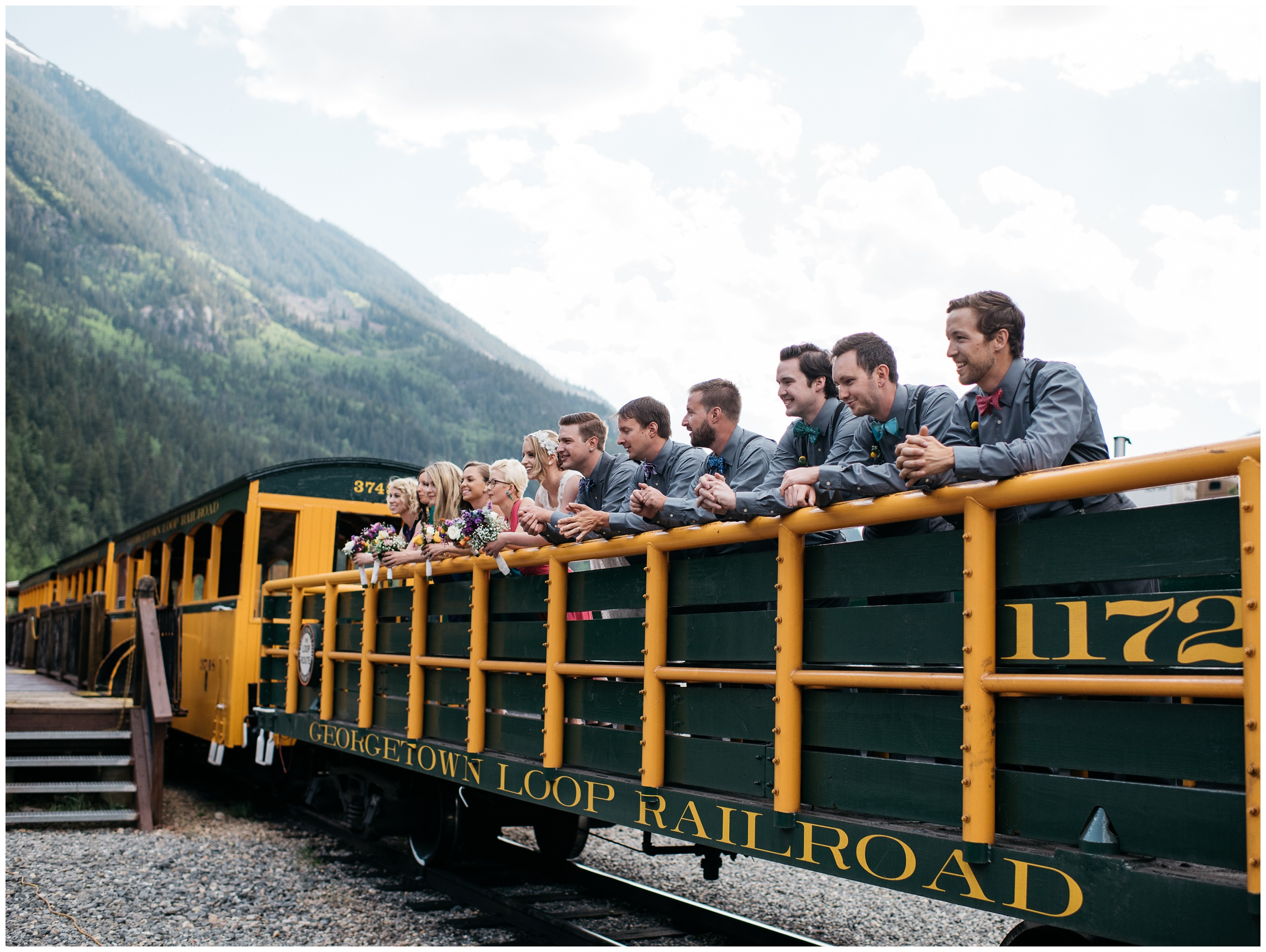 A wedding party on a historic train in Georgetown, Colorado. Wedding photography by Sonja Salzburg of Sonja K Photography.