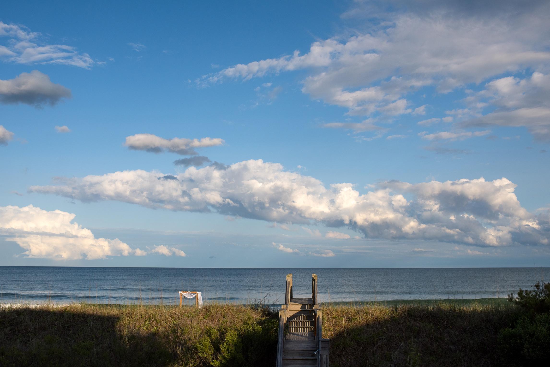 dunes-boardwalk-walkway-clouds-puffy-alter-myrtle-beach-south-carolina-Sonja-k-photography-sonjakphotography-honest-film-is-not-dead-best-fort-collins-northern-colorado-piedmont-good-creative-front-range-wedding-photographer-salzburg-rocky-mountains-meet-the-plains-look-portraits-family-southern-travel-destination-wyoming-artistic-denver-boulder-natural-lgbtq-gay-new-orleans-berlin-california-oakland-bride-groom-couple-outdoor-loveland-windsor-mountain-national-park-longmont-berthoud-arbor-trellis
