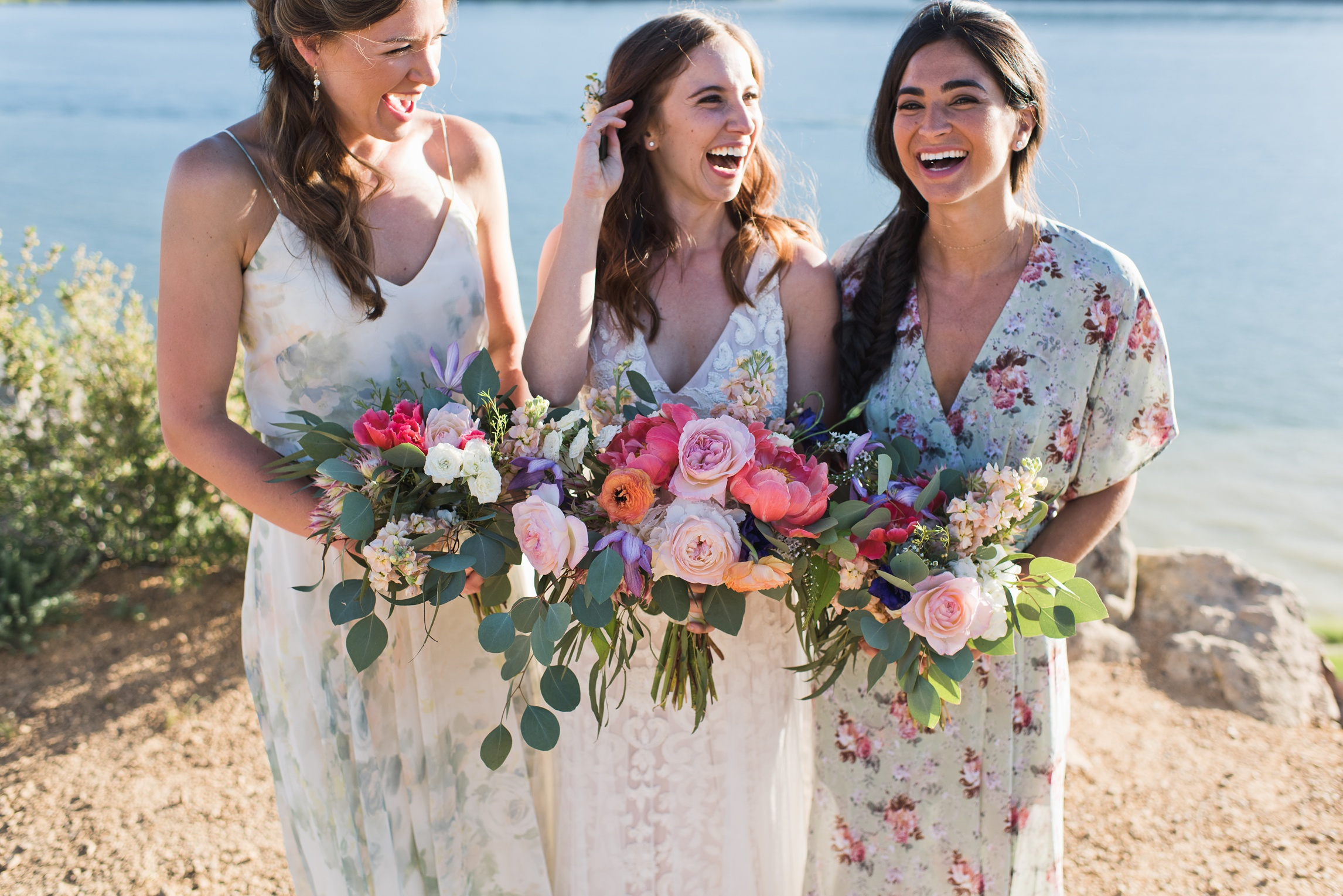 A bride and her bridesmaids at Horsetooth Reservoir in Fort Collins, Colorado. Wedding photography by Sonja Salzburg of Sonja K Photography.