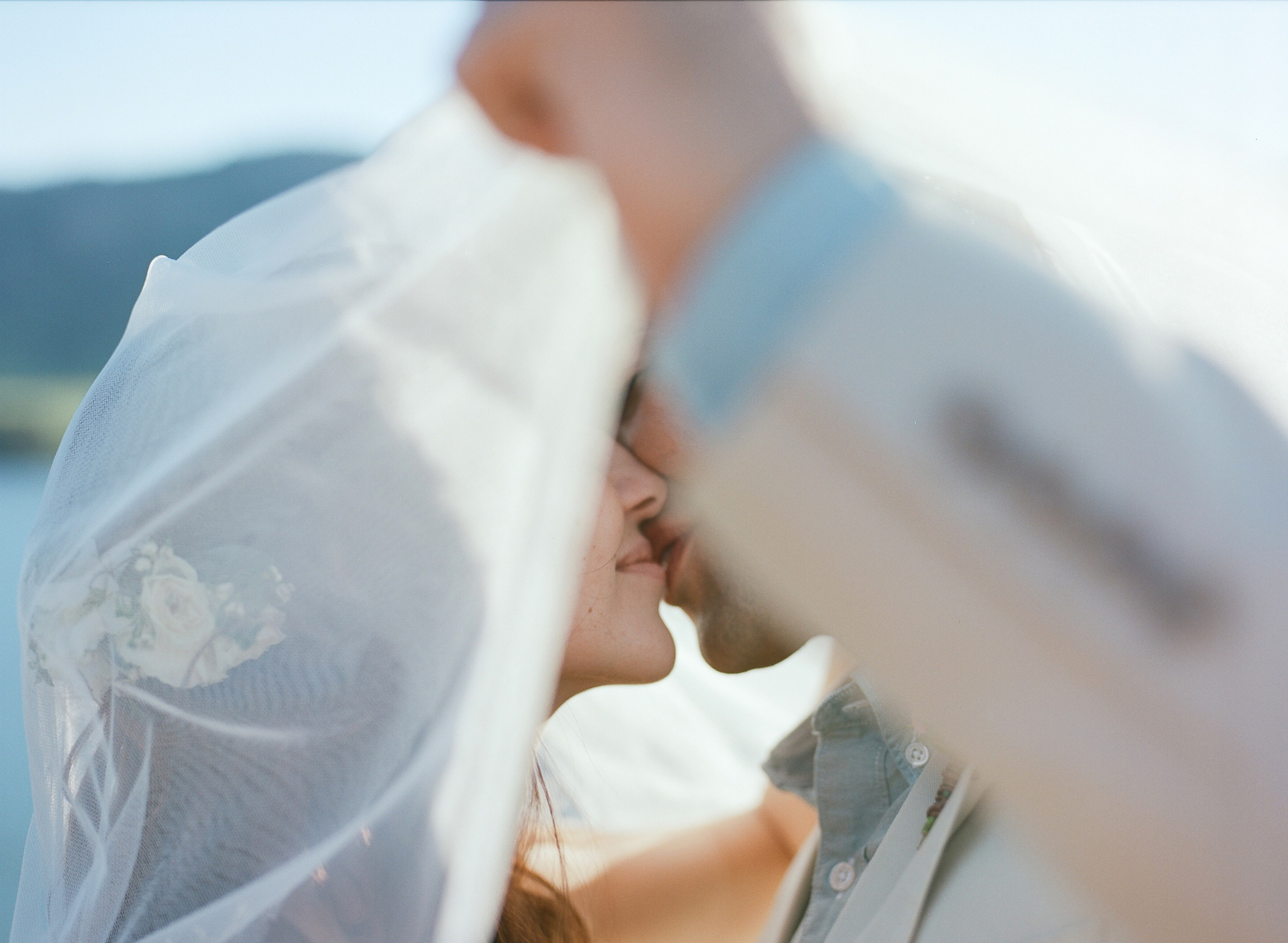 A bride and groom kiss on their wedding day. Wedding photography by Sonja Salzburg of Sonja K Photography.