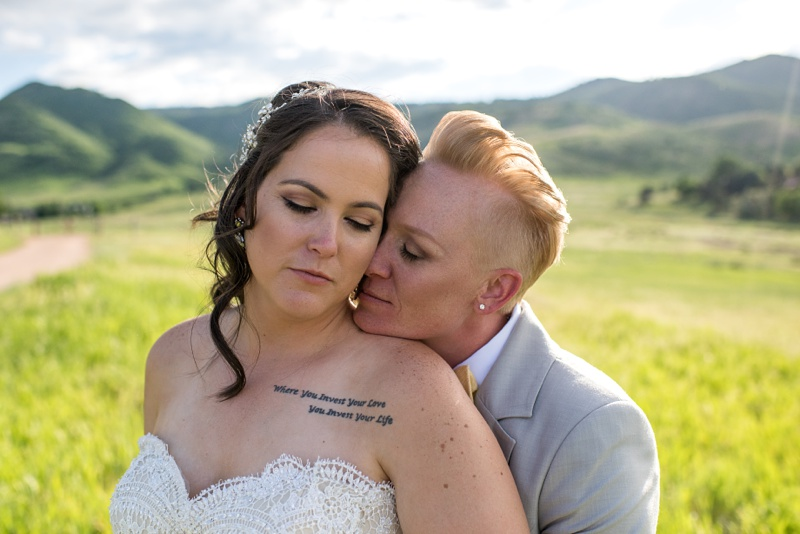 Newly married women at The Manor House in Ken-Caryl Ranch, Colorado. Wedding film photography by Sonja Salzburg of Sonja K Photography.