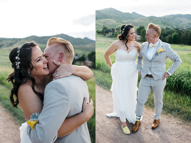 A beautiful lesbian couple embracing and showing off their cute shoes on their wedding day at the Manor House in Ken Karyl Colorado.  Photography by Sonja Salzburg of Sonja K Photography