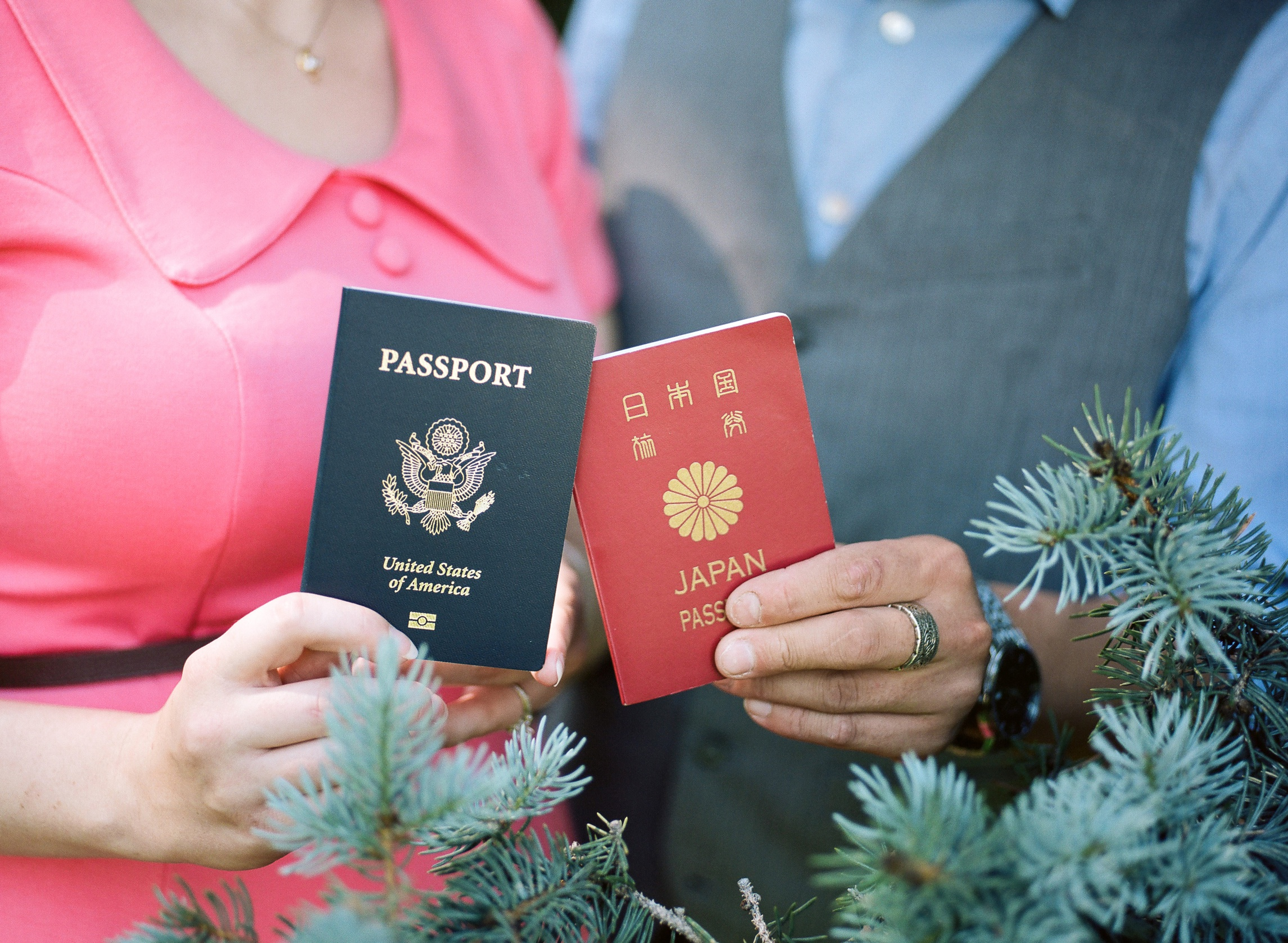 An engaged couples passports from the USA and from Japan. Engagement photography by Sonja Salzburg of Sonja K Photography.