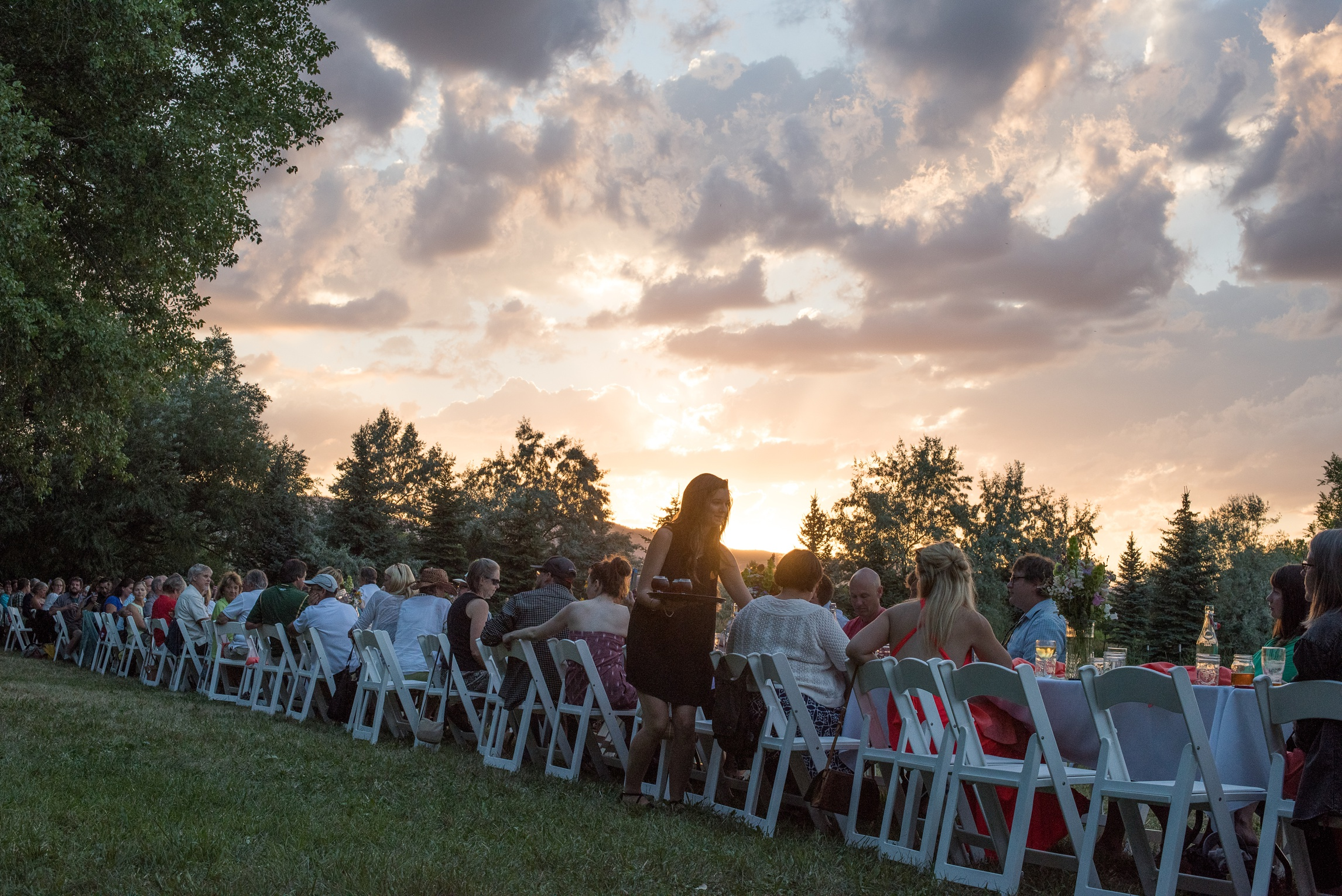 Sunset at the Fortified Collaborations Heart of Summer Farm Dinner at Happy Heart Farm in Fort Collins, Colorado. Event photography by Sonja Salzburg of Sonja K Photography.