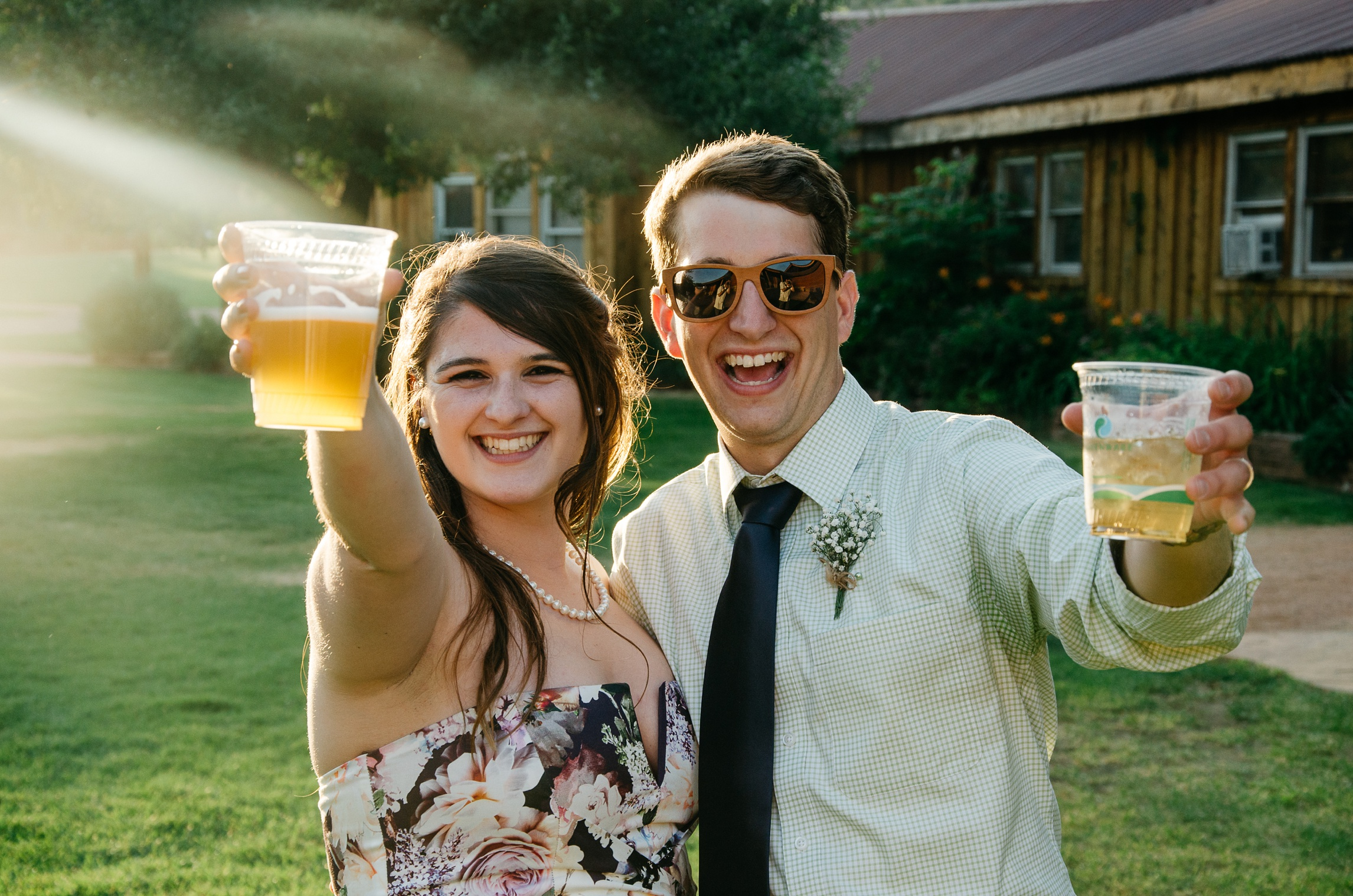 A bridesmaid and a groomsman at a wedding at Planet Bluegrass in Lyons, Colorado. Wedding photography by Max Salzburg of Sonja K Photography.