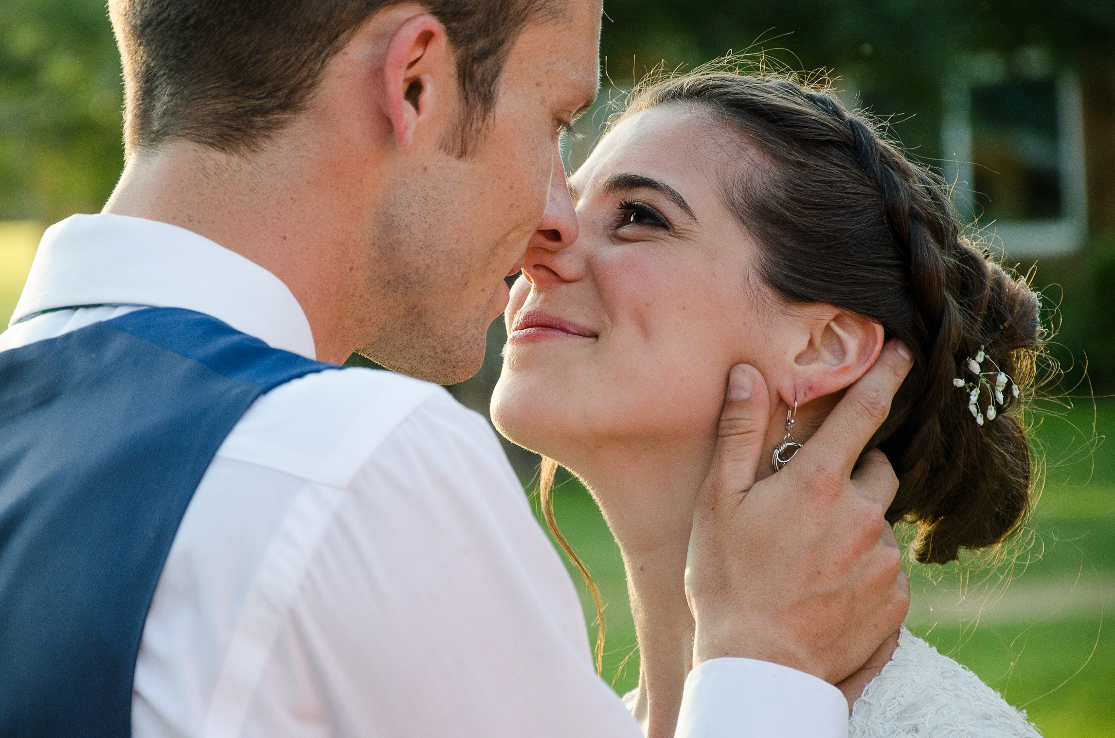 A newly married couple kiss at Planet Bluegrass in Lyons, Colorado. Wedding photography by Max Salzburg of Sonja K Photography.