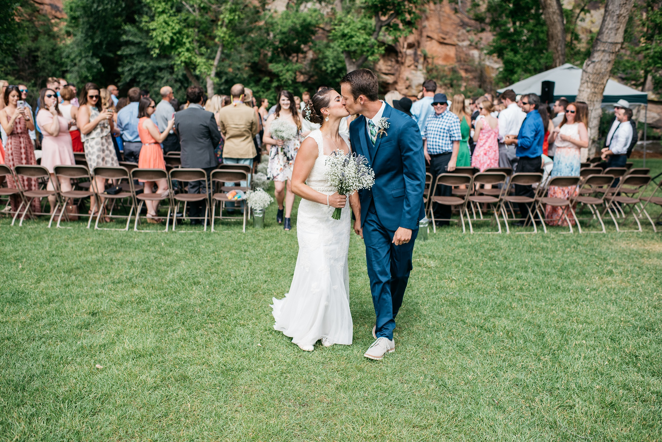 Melissa and Patrick kiss after their wedding ceremony at Planet Bluegrass in Lyons, Colorado. Wedding photography by Sonja Salzburg of Sonja K Photography.